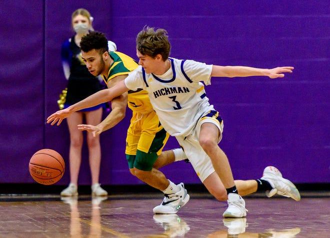 Hickman's Ben Wilson (3) battles Rock Bridge's Xavier Sykes (2) for a loose ball during a game Thursday night at Hickman High School.