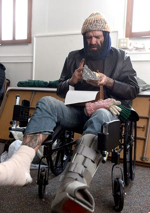 Donnie Brawley eats lunch Friday at the Turning Point Day Center at the United Methodist Church at 702 Wilkes Blvd. Brawley was dismissed from University Hospital on Wednesday after all of his toes but three had to be amputated because of frostbite. The frostbite has been an ongoing fight for Brawley the past few years.