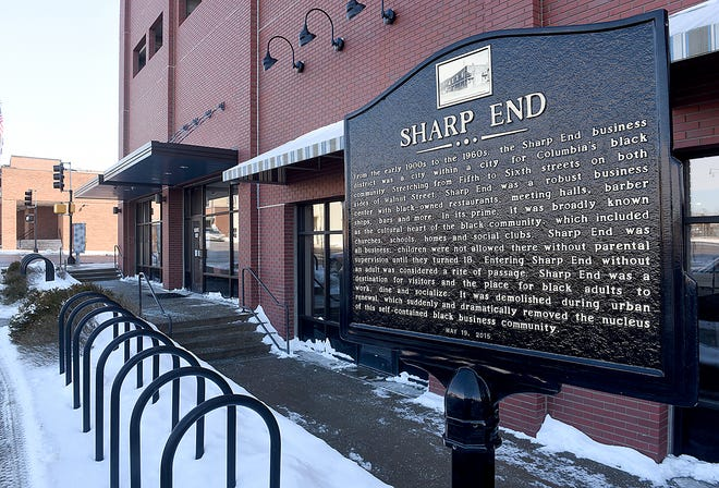 A sign in the 500 block of East Walnut on Friday commemorates the downtown area known for about 60 years beginning around 1900 as the Sharp End, where Black-owned businesses thrived within walking distance of downtown Columbia.