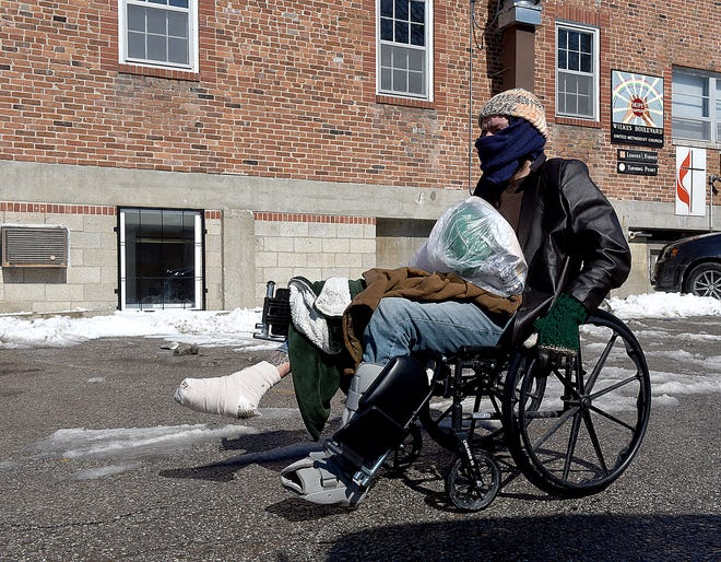 Donnie Brawley on Friday wheels himself to the front of the Turning Point Day Center at the United Methodist Church at 702 Wilkes Blvd. so he can enter the commons area by way of an elevator. Brawley was released from the hospital on Wednesday after having several toes amputated.