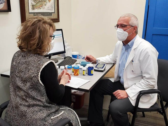 Pharmacist Jeff Steffey counsels a patient at Central Drug Store in Charlevoix. Medication consultation and management have become more prominent duties for pharmacists.