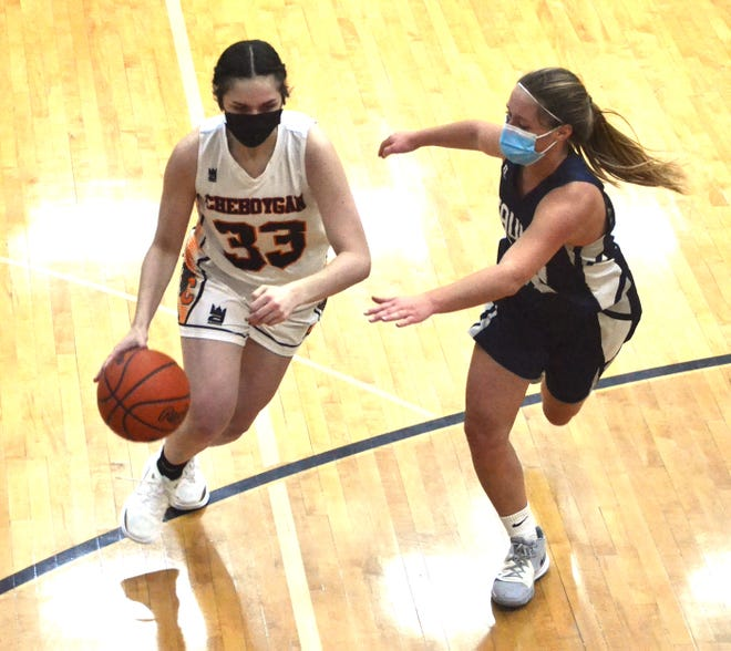 Sophomore Kenzie Burt (33) drives against a Sault Ste. Marie player during a recent varsity girls basketball matchup in Cheboygan. Burt scored four points and played solid defense for the Lady Chiefs in a victory over Newberry at home on Thursday.