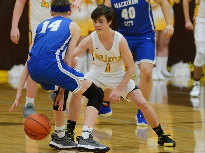 Pellston senior Sage LaLonde (right) defends during a game against Mackinaw City from last season. LaLonde scored 16 second half points to fuel the Hornets in a victory over Bellaire at home on Thursday.