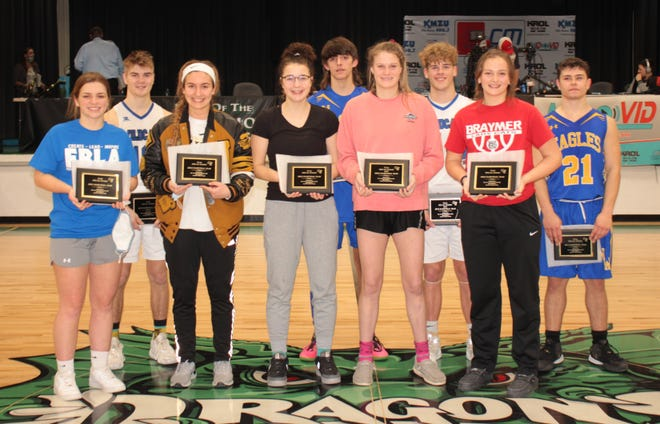 Most valuable players Samantha Rounkles (front, second from right) of Tina-Avalon and Patrick Warren (back, second from right) of Southwest Livingston headed up the 2021 Carroll-Livingston Activity Association conference tournament Bob Carter All-Tournament Teams after helping their respective squads to the tourney titles Thursday, Feb. 18. Joining Rounkles on the 5-players girls' squad were, from left, teammate Haley Rucker, Olivia Dooley of Norborne, Regan Crowe of Tina-Avalon, and Kennedy Stone of runnerup Braymer. Named to the boys' elite squad, in addition to Warren, were, from left, his SLHS teammate Wesley Hughes, Trey Stockwell and Isaac Zahner of runnerup Mendon: Northwestern, and (not present for photo) Jaeden Sears of Hale/Bosworth. The all-tourney team memorially honors late long-time Constitution-Tribune sports editor Bob Carter, who died in a traffic crash in late 2001.