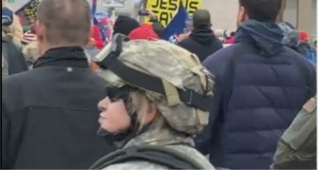 A photo taken from video and contained in an affidavit filed in federal court shows a woman in tactical gear authorities believe to be Sandra Parker