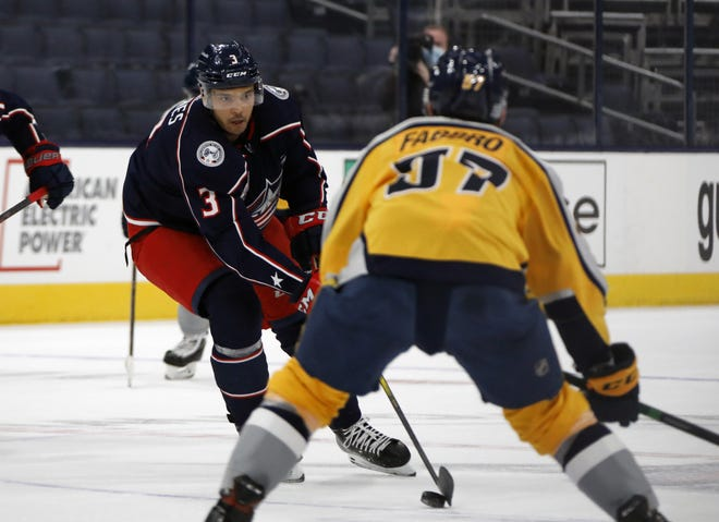 Blue Jackets defenseman Seth Jones, here carrying the puck against Nashville  defenseman Dante Fabbro on Thursday, has overcome a slow start and has seven assists in the past eight games.