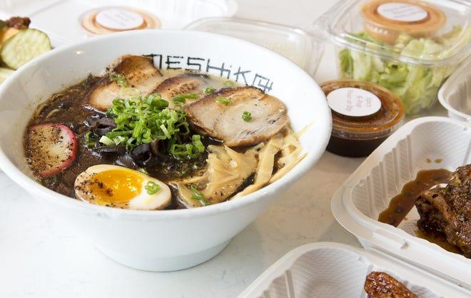 Meshikou black, a dynamic umami-bomb with garlic and mushroom notes at Meshikou Ramen