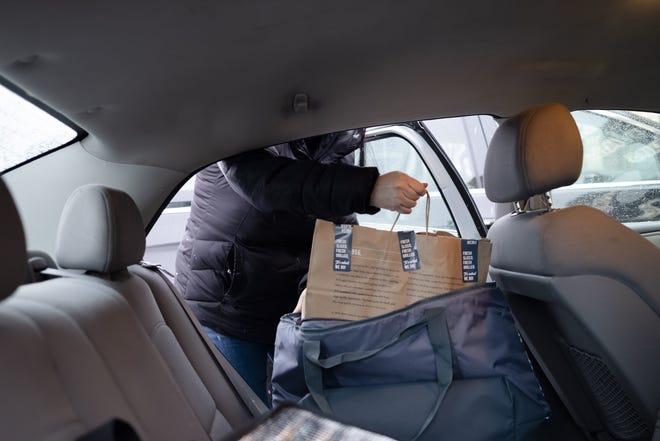 Cassandra Flore places a DoorDash order from Jersey Mike's inside the hot bag in her back seat.