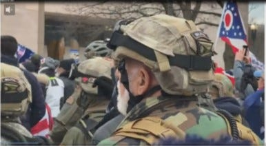 A photo taken from video and contained in an affidavit filed in federal court shows a man in tactical gear authorities believe to be Bennie Parker