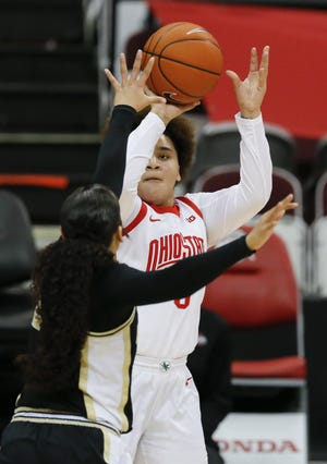 Ohio State's Kateri Poole shoots over Purdue's Kayana Traylor on Thursday at Value City Arena. Poole scored nine points while filling in for Madison Greene.
