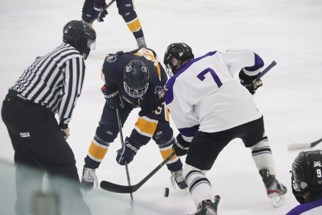 Jack Doda and Zak Kennett vie for a faceoff in Crookston's 7-1 loss to Red Lake Falls on Feb. 18 at the Cardin-Hunt Arena in Red Lake Falls.