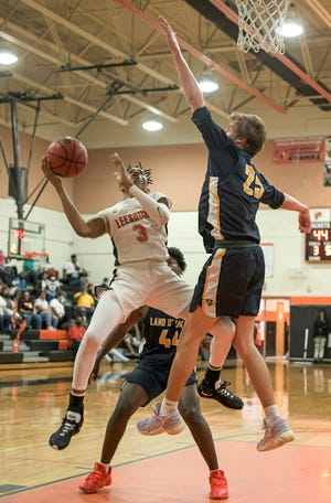 Leesburg's Devin Graham (3) tries to score during Thursday Class 5A-Region 2quarterfinal game against Land O' Lakes at The Hive in Leesburg. [PAUL RYAN / CORRESPONDENT]