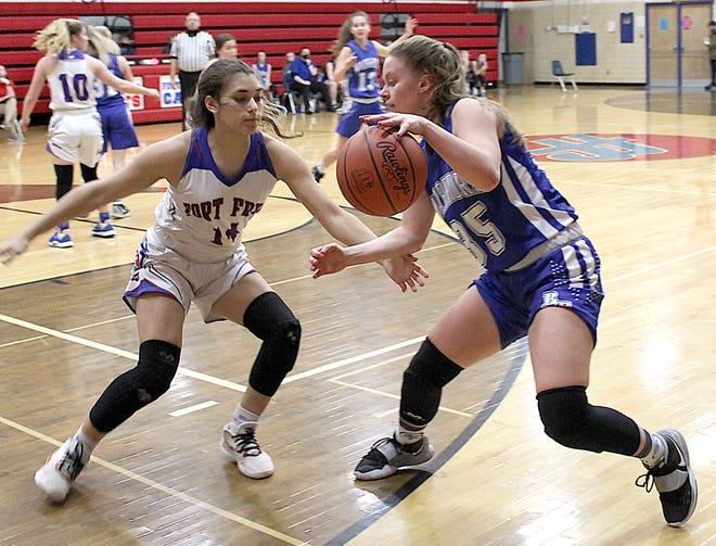 Buckeye Trail senior Brooke Baird (35) attempts to get past Fort Frye's Riley Medley (14) during Thursday night's Division III sectional championship game at Fort Frye High School.