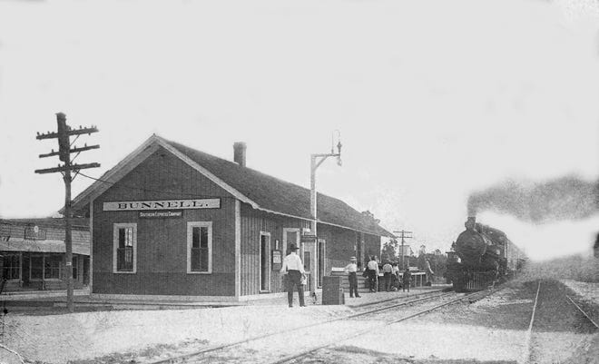 Passengers wait for the train at the Bunnell Depot around 1912. Utley James White started the steel railroad in the late 1800s to haul wood from his lumber business, and by 1886 it went through Bunnell and eventually to Daytona Beach. He sold his railroad to Henry Flagler around 1890.