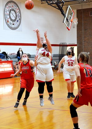 Tekonsha's Emily Davis fires away from the field, scoring the Indians first points of the game Thursday versus Litchfield.