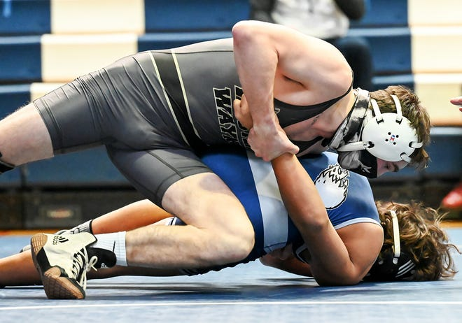 "Western Wayne's Matt Leslie has his opponent right where he wants him during recent Lackawanna League varsity wrestling action. The Wildcat senior is now a member of the prestigious ""100-Win Club,"" boasting a career record of 100-25-0."
