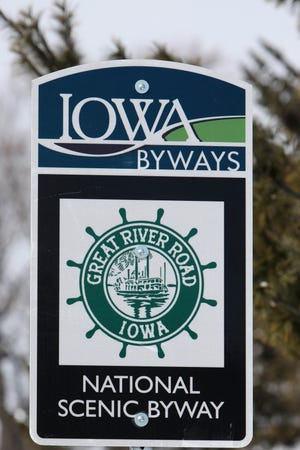 A sign promoting Iowa's Great River Road is shown Friday along Harrison Avenue in Burlington. Iowa's Great River Road, a National Scenic Byway, earned a new designation of All-American Road by the U.S. Department of Transportation through the Federal Highway Administration.
