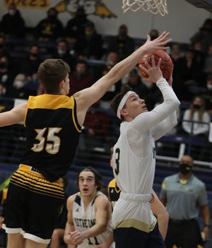 Notre Dame High School's Matthew Johnson (3) has his shot blocked by Kade Benjamin (35) during their Class 1A district seminal game against New London, Thursday Feb. 18, 2021 at Notre Dame's Father Minett Gymnasium.