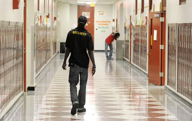 "A security guard makes his rounds at a Duval County high school in this Times-Union file photo. An appeals court this week rejected a lawsuit filed in Duval County challenging armed ""guardians"" on campuses."