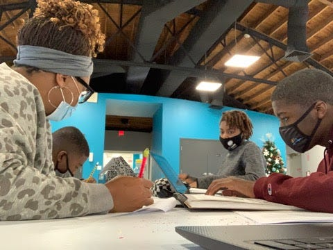 """Akili Colson (from left), Bertram Alford, JAMS Education Director Erin Kendrick and Zach Israel take part in a workshop for """"The 400 Project"""" at the Jacksonville Arts & Music School. The film is being shown at the annual Kingsley Heritage Celebration, which is taking place virtually this year."""