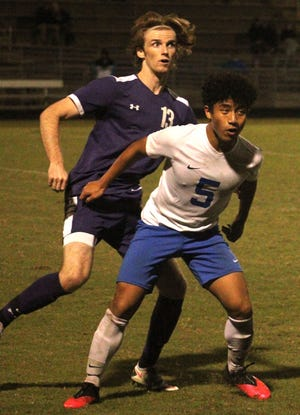 Fletcher midfielder Will Sylvan (13) and Stanton midfielder Joseph Alberto (5) prepare to challenge for an approaching ball during a regular-season soccer game. Both teams will be in action in Saturday's regional semifinals.