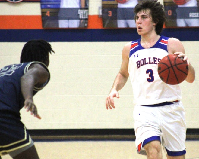 Bolles guard Bobby Crouch (3) dribbles against Paxon in a regional quarterfinal. Crouch scored 40 points in the game.