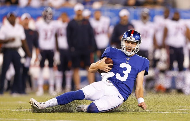 Former New York Giants quarterback Alex Tanney slides on the field during the fourth quarter of a game against the Chicago Bears on Friday, Aug. 16, 2019, in East Rutherford, N.J.