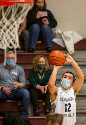 """Monmouth-Roseville senior Quincy Lovitt-Talivaa shoots a 3-pointer during the Titans' 70-42 home win over West Hancock on Thursday at """"The Shoebox."""""""