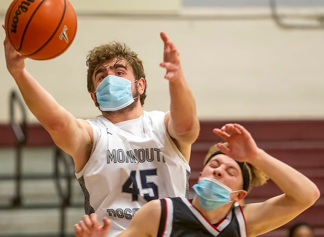 """Monmouth-Roseville junior Ben Anderson, left, goes over West Hancock's Issac Siegfried for a rebound during Thursday's 70-42 win at """"The Shoebox."""""""