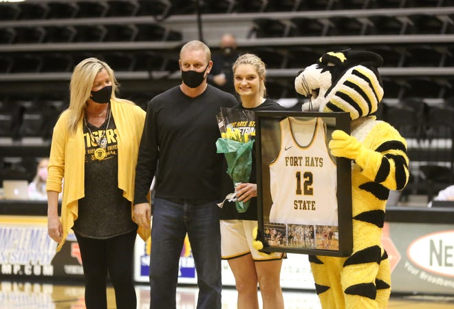 Fort Hays State senior Madison Mittie, is accompanied by her mother, Shanna, and her father, Jeff, during Thursday's night senior recognition.