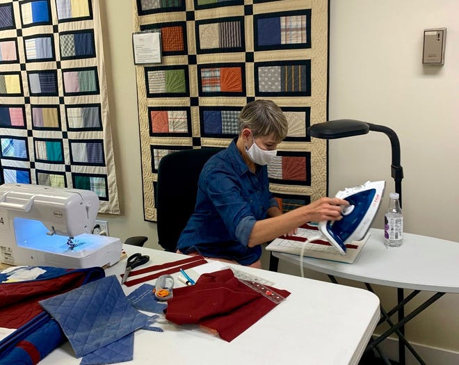 A volunteer at Living Threads Ministry in Zeeland works on a project. The nonprofit is dedicated to making quilts and — now — pillows for families suffering from the loss of a loved one.