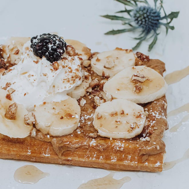 """Waffles at The 205 launched in February at The 205 Coffee Bar in downtown Holland. Pictured, a Peanut Butter Banana """"croiffle,"""" with peanut butter, sliced bananas, praline pecans, cinnamon maple syrup and fresh banana whip."""