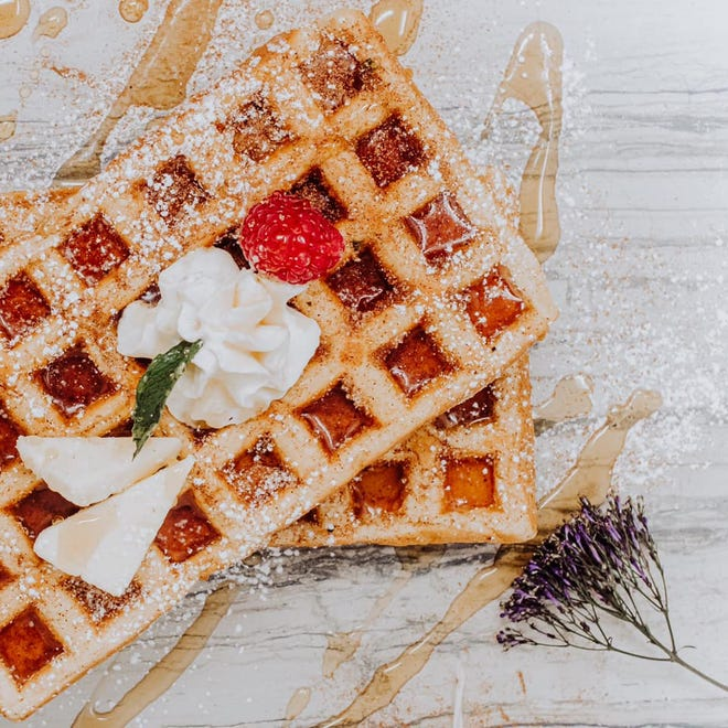 """Waffles at The 205 launched in February at The 205 Coffee Bar in downtown Holland. The business now serves """"croiffles."""" Pictured is a Churro-flavored croiffle with cinnamon sugar, syrup, butter and cinnamon whipped cream."""