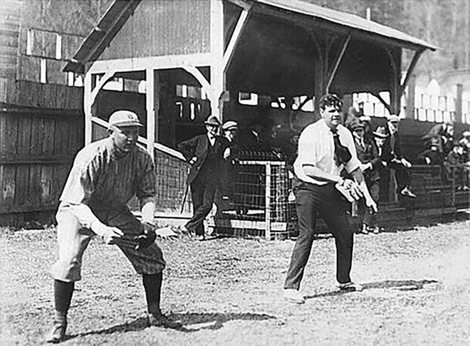 Babe Ruth (in street clothes) gets in a little spring training at Whittington Park in Hot Springs, Ark., in 1921.