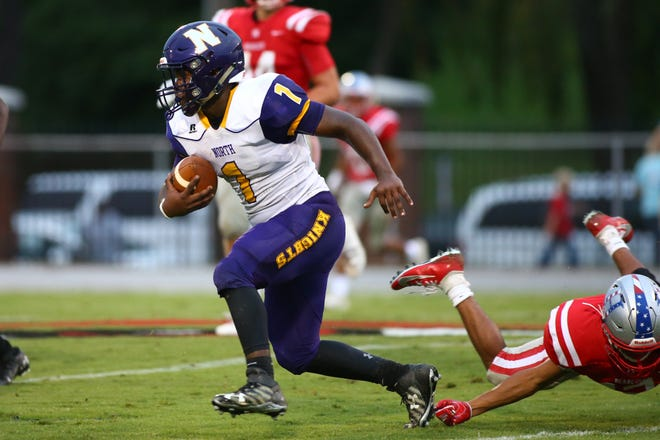 North Henderson's Windell Flowers carries the ball during last season's game at Hendersonville High School.