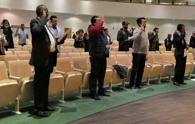 Forty people, representing 18 countries, are sworn in as U.S. citizens on Feb. 19 in Wichita.