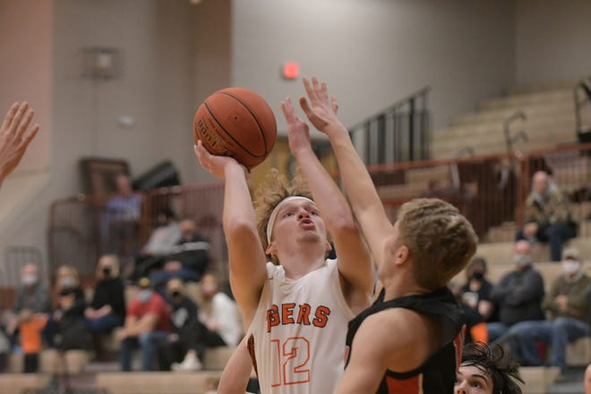 Kirksville's Lane Feeney puts up a shot through contact against Chillicothe.