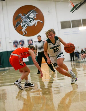 Nordonia guard Taylor Root drives to the basket during the Knights' 53-20 win over Massillon in a girls basketball Division I sectional final Thursday night. [Tim Howard/For the Kent Weeklies]