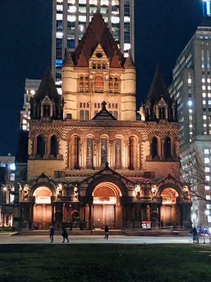 Here is the Trinity Church in Copley Square at night. The building was opened in 1877.