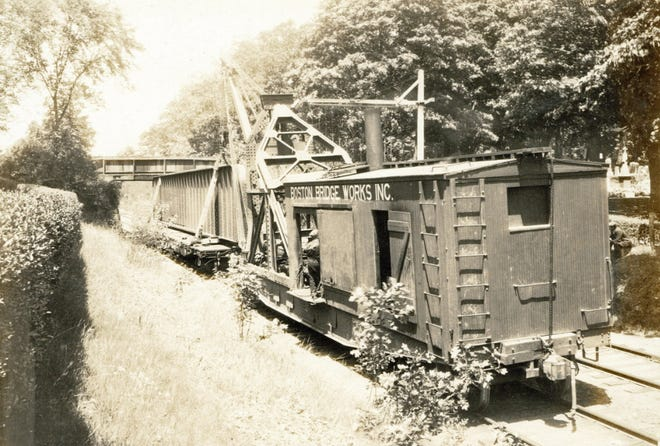 A 59-ton girder at the Cedar Grove Cemetery is on its way to the Codman Street Bridge in 1927.  Learn more at the Boston City Archives (https://cityofboston.access.preservica.com).