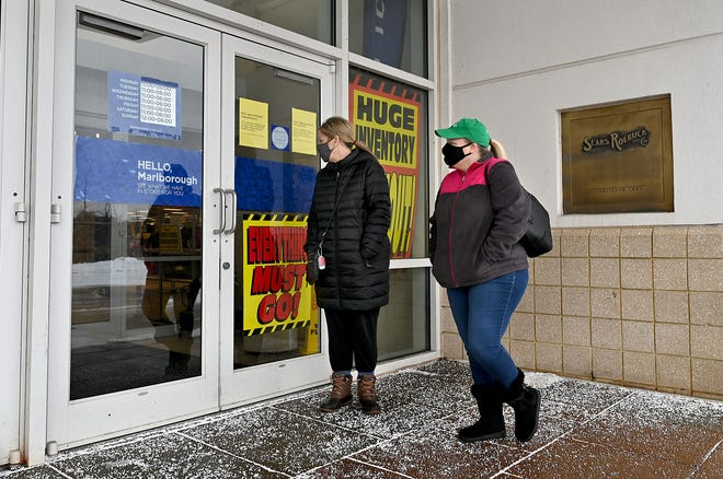 After learning that Sears at the Solomon Pond Mall would be closing, Wendy Bower and AnnMarie Benoit, both of Hudson, wait for the 11 a.m. opening to take advantage of store-closing sales, Feb. 19, 2021.