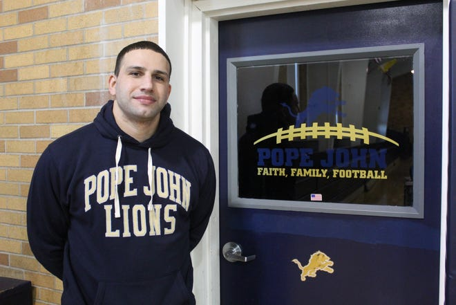 Dominique Gaston poses for a photo at Pope John XXIII Regional High School, where he will serve as the school's next head coach for its varsity football program