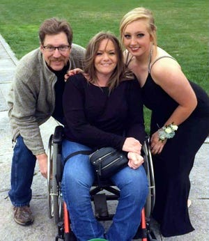Cherie Chabot, center, poses with husband Mark and daughter Rhilea in this recent photo. Chabot's friend Diane Philo has created a Go Fund Me account to raise funds for a new handicap-accessible van for her.