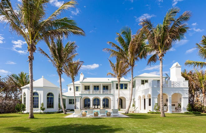 With Bermuda-style architecture, the oceanfront side of a house at 901 N. Ocean Blvd. has two loggias facing the pool along with an octagonal study. The just-completed house is priced, furnished, at $84 million.