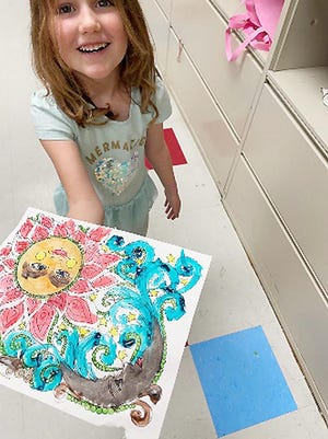 Sophia F. age 5 shows off her art masterpiece.