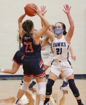 Prairie Central's Mariya Sisco (21) tries to disrupt Pontiac's Addison Masching during Thursday's Illini Prairie Conference girls' basketball game.