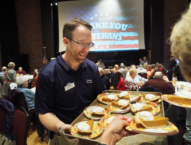 Todd Henley, seen serving veterans at a Harvest Luncheon at the Star Theatre in Kittery, Maine, is moving from the Kittery Recreation Department to take over the department in Portsmouth.
