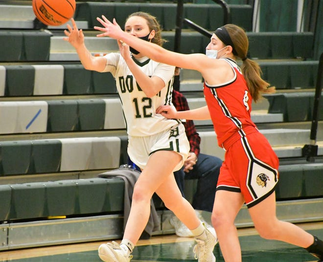 Dover's Lanie Mourgenos, left, makes a pass as she is defended by Spaulding's Abby Ward in a Division I girls basketball game earlier this season. The Dover girls team, which has 0-5 in Division I play this season, is the No. 1 seed for the upcoming Division I tournament.