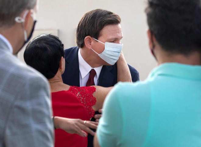 Gov. Ron DeSantis arrives at the Hilton Airport Palm Beach in West Palm Beach Friday, February 19, 2021.