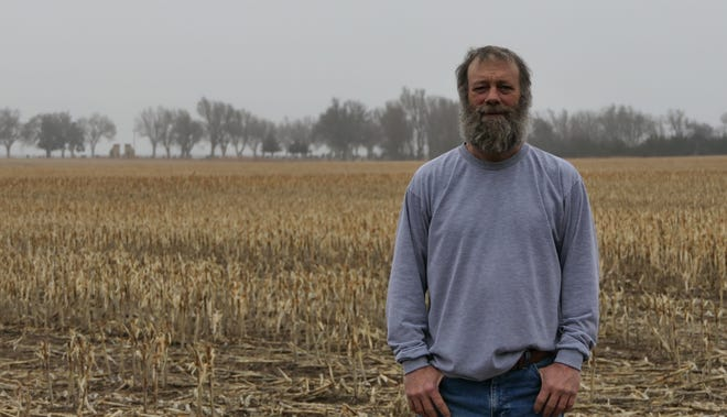 Ki Gamble, Greensburg, stands out in his Kiowa County fields where he had pledged to do the little things right in farming and growning sorghum. Gamble Farms was recently named National Sorghum Producers Yield Contest winners.